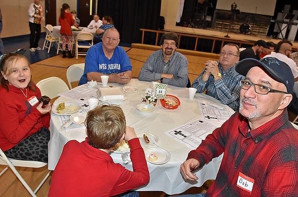 (Brad Davis/The Register-Herald) United Methodist Temple's Community Christmas Dinner Sunday afternoon inside The Place.