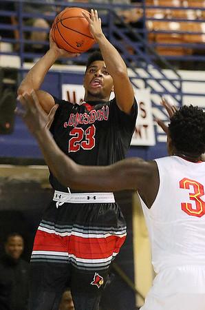 Brad Davis/The Register-Herald<br /> Jonesboro's James Walker Jr. shoots against Oak Hill Academy Wednesday night at the Beckley-Raleigh County Convention Center.