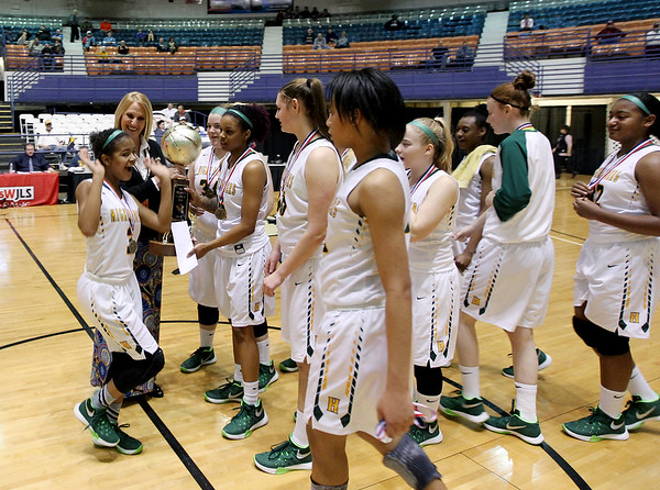 Huntington recieves their trophy for the Class AAA Girls Championship after defeating George Washington at the Big Atlantic Classic Saturday in Beckley.
