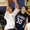 (Brad Davis/The Register-Herald) Greater Beckley Christian's Jonathan Moore drives to the basket as Calvary's Jacob Tincher defends Thursday afternoon at the Beckley-Raleigh County Convention Center.