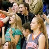 (Brad Davis/The Register-Herald) Wyoming East students react to events on the court as their Lady Warrior classmates take on the Summers County Lady Bobcats in a sectional championship game at Liberty High School in Glen Daniel Thursday night.