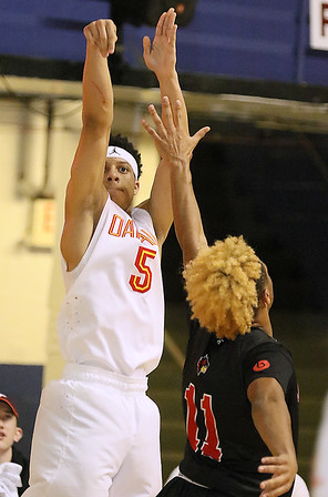 Brad Davis/The Register-Herald<br /> Oak Hill Academy's Lindell Wigginton fshoots from three-point range before Jonesboro's Kenneth Qualls can get to him Wednesday night at the Beckley-Raleigh County Convention Center.