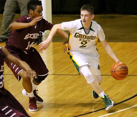 Greenbrier East's Seth Brown hustles up the court during the class AAA championship game Saturday night at the Beckley-Raleigh County Convention Center.