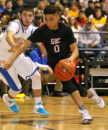 Greater Beckley Christian's Jay Moore drives around Van's Taylor Jarrell during the class A championship game Saturday night at the Beckley-Raleigh County Convention Center.