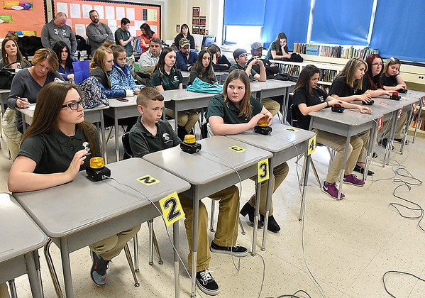 (Brad Davis/The Register-Herald) Teams of 8th graders from Park Middle School (left) and Monroe County listen to questions ready to hit the buzzer as they compete in the History Bowl Saturday afternoon at Summers County Middle School.