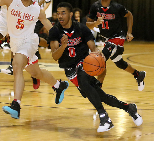 Brad Davis/The Register-Herald<br /> Jonesboro's Tariq Jenkins rushes up the court against Oak Hill Academy Wednesday night at the Beckley-Raleigh County Convention Center.