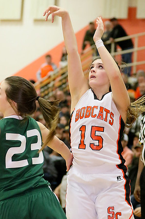 Summers County's Morgan Miller hits from three-point range before Wyoming East's Katie Daniels can stop her Friday night in Hinton.