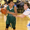 Brad Davis/The Register-Herald<br /> Fayetteville's Marcus Lively looks for an open teammate as Van's Tyler Stewart defends Monday night at the Beckley-Raleigh County Convention Center.