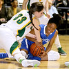 Brad Davis/The Register-Herald<br /> Greenbrier East's Lauren Lindsey battles for a loose ball with Capital's Jertaya Hall Thursday night at the Beckley-Raleigh County Convention Center.