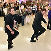(Brad Davis/The Register-Herald) Zach Houtz, left, and Zach Kuhn bust a few moves as they demonstrate their dancing skills at the Charleston-based AAA Entertainment booth during the Bridal, Prom and Special Occasions Fair Saturday afternoon at the Beckley-Raleigh County Convention Center.