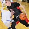 Greater Beckley Christian's Devin Acord drives around Van's Tyler Stewart during the class A championship game Saturday night at the Beckley-Raleigh County Convention Center.