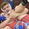 Independence's Alex Daniels (top) and Midland Trail's Christian McGuire share a couple of laughs as the two battle it out during their 220-pound weight class championship match against Saturday night at Woodrow Wilson High School.