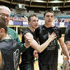 Wyoming East players and coaches react after winning the Class AA Boys Championship over Robert C. Byrd after two-overtimes at the Big Atlantic Classic Saturday in Beckley.