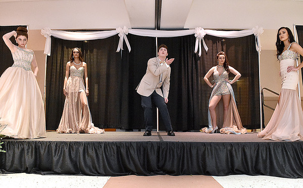 (Brad Davis/The Register-Herald) Young models show off an assortment of prom selections during the fashion show portion of the Bridal, Prom and Special Occasions Fair Saturday afternoon at the Beckley-Raleigh County Convention Center.