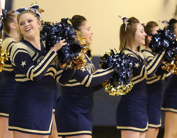 Brad Davis/The Register-Herald<br /> Greenbrier West cheerleaders perform Monday night at the Beckley-Raleigh County Convention Center.