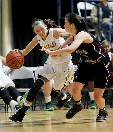 Huntington's Alexia Sheffield (13) drives past a George Washington player during their Class AAA Girls Championship at the Big Atlantic Classic Saturday in Beckley.