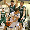 Brad Davis/The Register-Herald<br /> Fayetteville's Dylan Doyle, left, and Stevie Price try to contain Van's Tyler Stewart as he works the ball up the court Monday night at the Beckley-Raleigh County Convention Center.