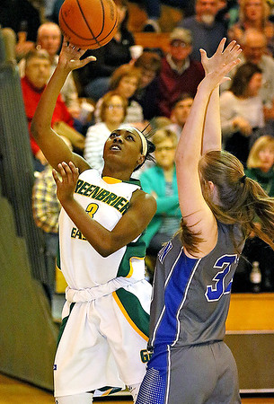 (Brad Davis/The Register-Herald) Greenbrier East's Kiara Smith drives and scores as Princeton's Autumn Bradley defends Friday night in Fairlea.