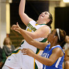 Brad Davis/The Register-Herald<br /> Greenbrier East's Lexi Tincher drives to the basket as Capital's Alex Gray defends Thursday night at the Beckley-Raleigh County Convention Center.