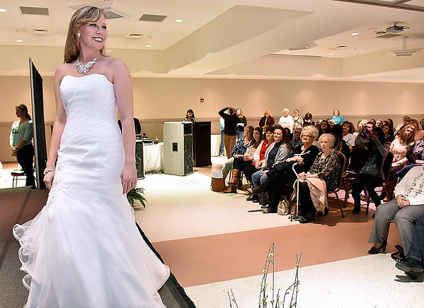 Bridal gown model Jessica Potticher walks the stage during the Fit For a Queen Fashion Show portion of this year's Bridal, Prom and Special Occasions Fair Saturday afternoon at the Beckley-Raleigh County Convention Center.