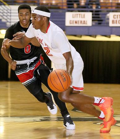 Brad Davis/The Register-Herald<br /> Oak Hill Academy's Matt Coleman drives against Jonesboro Wednesday night at the Beckley-Raleigh County Convention Center.