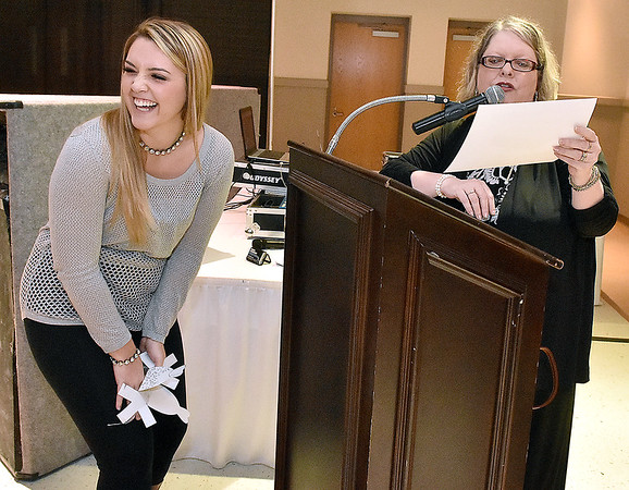 Bride-to-be Katelyn Bishop (left) soon to be Lester, reacts as she learns what her grand prize includes during the Bridal, Prom and Special Occasions Fair Saturday afternoon at the Beckley-Raleigh County Convention Center.