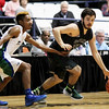 Wyoming East's Alec Lusk (22) dribbles past a Robert C. Byrd defender during their Class AA Boys Championship at the Big Atlantic Classic Saturday in Beckley.