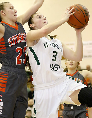 (Brad Davis/The Register-Herald) Wyoming East's Kara Sandy drives and scores as Summers County's Brittney Justice defends Thursday night in Glen Daniel.