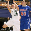 Brad Davis/The Register-Herald<br /> Wyoming East's Misa Quesenberry tries to drive to the basket against tough defense from Morgantown's Shelby Boyle Thursday night at the Beckley-Raleigh County Convention Center.