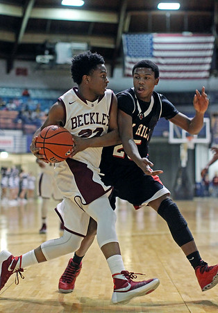 Oak Hill's Andrew Work (25) tries to guard Woodrow Wilson's Isaiah Francis (22) during the second quarter of their basketball game Tuesday in Beckley.