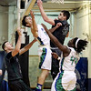 Wyoming East's David Carte (40) blocks a shot by a Robert C. Byrd player during their  Class AA Boys Championship at the Big Atlantic Classic Saturday in Beckley.