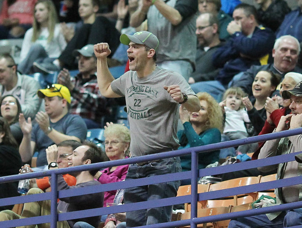 A Wyoming East fan reacts to a last second buzzer beater by Wyoming East's David Carte to close the third quarter during their  Class AA Boys Championship against Robert C. Byrd at the Big Atlantic Classic Saturday in Beckley.