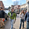 From left, Andy Davis, Bicycle and Pedestrian Trail Coordinator for Active Southern West Virginia, Adam Hodges from West Virginia State University, ASWV Executive Director Melanie Seiler and Chairman William Massey tour downtown as they look over some areas around the Mount Hope area set for upcoming development projects during a visit to the town Wednesday afternoon.