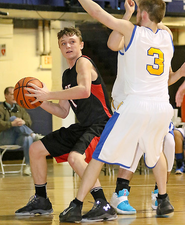 Greater Beckley Christian's Will Mullins tries to drive to the basket as Van's Logan Crouse defends during the class A championship game Saturday night at the Beckley-Raleigh County Convention Center.