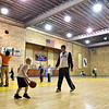 Mount Hope Youth Basketball League players from the kindergarten (near) and first through second grade (background right) divisions hold practice sessions Thursday night in the city's recreation and community center.