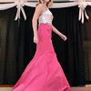 (Brad Davis/The Register-Herald) A model shows off a dress during the fashion show portion of the Bridal, Prom and Special Occasions Fair Saturday afternoon at the Beckley-Raleigh County Convention Center.