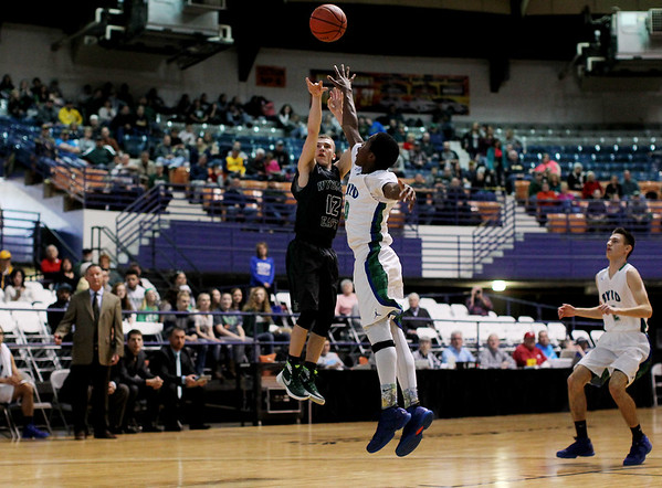 Wyoming East's Johnathan Sims (12) attempts a shot during their  Class AA Boys Championship game against Robert C. Byrd at the Big Atlantic Classic Saturday in Beckley.