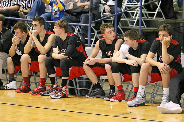 The Greater Beckley Christian bench reacts during the closing moments of the Crusaders' loss to Van in the class A championship game Saturday night at the Beckley-Raleigh County Convention Center.