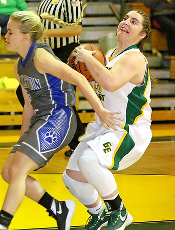 (Brad Davis/The Register-Herald) Princeton's Danielle Hall over-persues Greenbrier East's Lexi Tincher as she drives and scores Friday night in Fairlea.