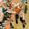Summers County's Whittney Justice comes away with a loose ball as teammate Jordan Sigmon, left, and Wyoming East's Megan Davis (#11) and Jazz Blankenship crash into each other trying to recover it Friday night in Hinton.