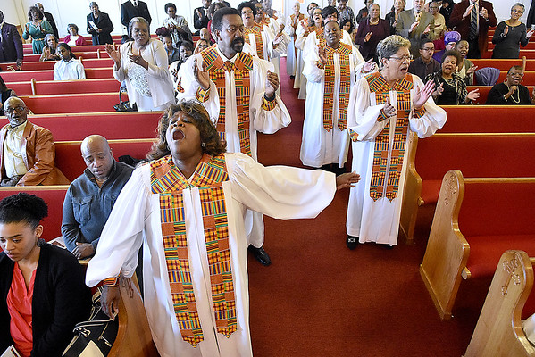 (Brad Davis/The Register-Herald) Members of the choir sing amongst the congregation during the closing moments of Central Baptist Church's Black History Month celebration Sunday afternoon.