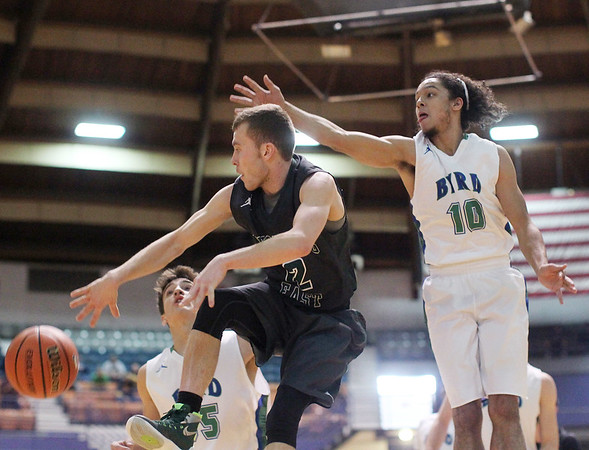 Wyoming East's Johnathan Sims (12) as Robert C. Byrd's Jemil North (10) tries to block it during their Class AA Boys Championship at the Big Atlantic Classic Saturday in Beckley.
