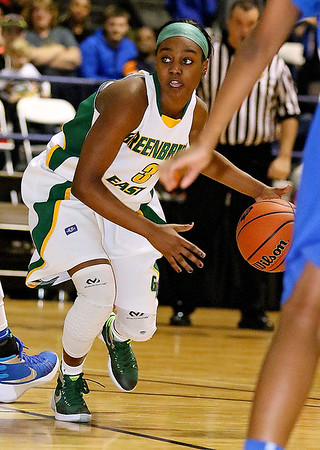 Brad Davis/The Register-Herald<br /> Greenbrier East's Kiara Smith works her way up the court against Capital Thursday night at the Beckley-Raleigh County Convention Center.