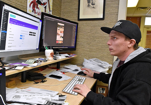 (Brad Davis/The Register-Herald) Co-owner Jamie Smith works inside Kid in the Background Multimedia Factory at their 105 Prince Street location February 17.