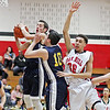 Shady Spring's (3) grabs a rebound as Michael Holt (10) and Oak Hill's Dietrick Penn (30) go after it during the first quarter of their class AAA sectional basketball game in Oak Hill on Monday. (Chris Jackson/The Register-Herald)