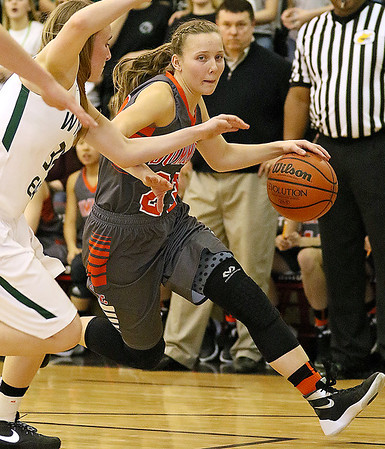 (Brad Davis/The Register-Herald) Summers County's Brittney Justice drives to the basket around Wyoming East's Gabby Lupardus Thursday night in Glen Daniel.