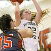 (Brad Davis/The Register-Herald) Wyoming East's Gabby Lupardus drives to the basket as Summers County's Morgan Miller defends Thursday night in Glen Daniel.