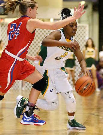 Greenbrier East's Kiara Smith tries to get around Morgantown's Paige Poffenberger as she looks for a lane Friday night at the Beckley-Raleigh County Convention Center.