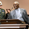 (Brad Davis/The Register-Herald) Lieutenant Leon Triggs, right, speaks briefly after being honored for both his service during World War II and for his 90th birthday during Heart of God Ministries' Black History Month celebration Sunday evening. Triggs received a special plaque and had the opportunity to command the American Legion Post 32 Honor Guard that was on hand to join in the festivities.