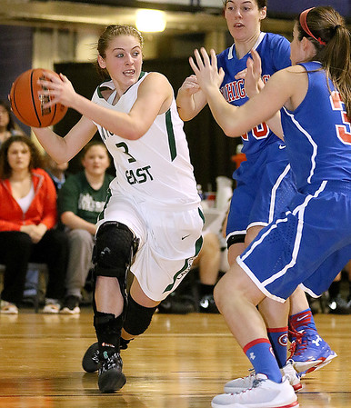 Brad Davis/The Register-Herald<br /> Wyoming East's Kara Sandy runs into a wall of tough defense from Morgantown's Courtney Quinn (nearest right) and Shelby Boyle (background right) as she tries to work underneath Thursday night at the Beckley-Raleigh County Convention Center.